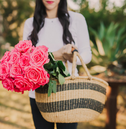 Dr. Alejandra Carrasco holding a basket of flowers